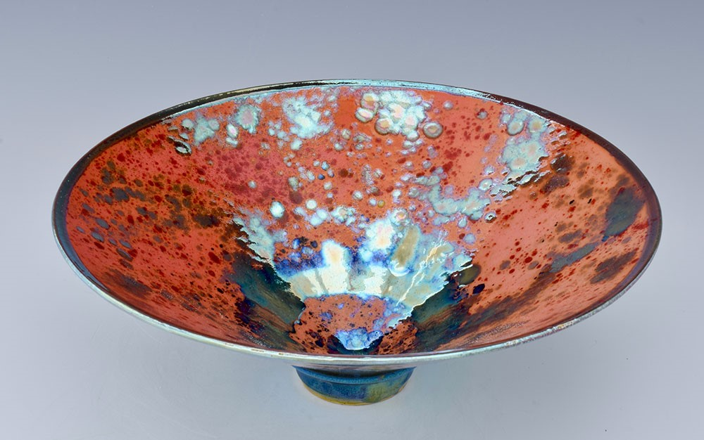 Flared pink bowl, with a shiny and iridescent finish. Made by Sutton Taylor