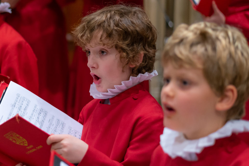 Two choirboys singing